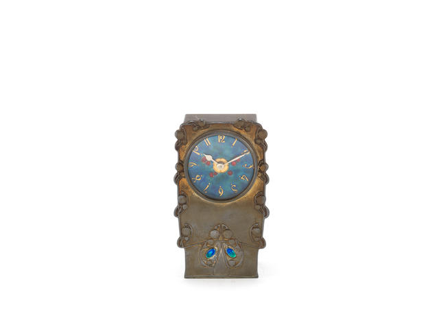 a liberty & co 'tudric' pewter and enamel timepiece designed by Archibald knox STAMPED MAKER'S MARKS; CIRCA 1910
