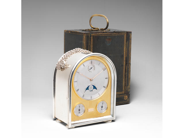 A very fine and exceptionally rare late 19th century silver humpback travelling clock with moonphase, running seconds and annual calendar.  In the original gilt-tooled green leather travelling/presentation case and with original silver double-ended safety key.  Jump, London.  The silver case hallmarked ACJ, London 1893.  2