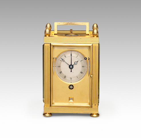 A fine and rare early 19th century Swiss ormolu travelling clock with single train and grande sonnerie striking, alarm and calendar