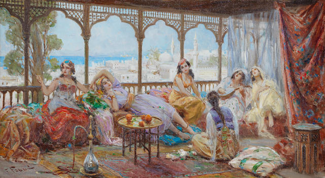 Fabio Fabbi (Italian, 1861-1946) Harem girls resting on a terrace, the coast beyond unframed