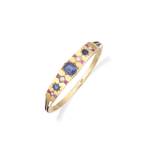 An early 20th century sapphire, ruby and pearl bangle