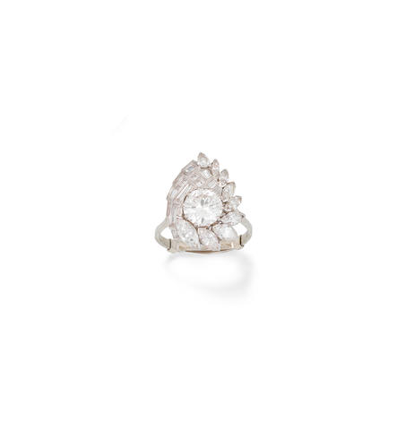 A diamond cluster ring, by John Donald,