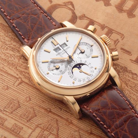 Patek Philippe. A fine 18K rose gold manual wind perpetual calendar chronograph wristwatch with moon phase Ref: 3970, Sold 26th July 1991