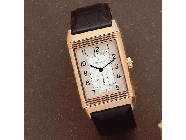 Jaeger-LeCoultre. An 18K rose gold manual wind calendar reversible rectangular wristwatch with 24-hour indication  Night and Day, Ref: 273.2.85, Circa 2010