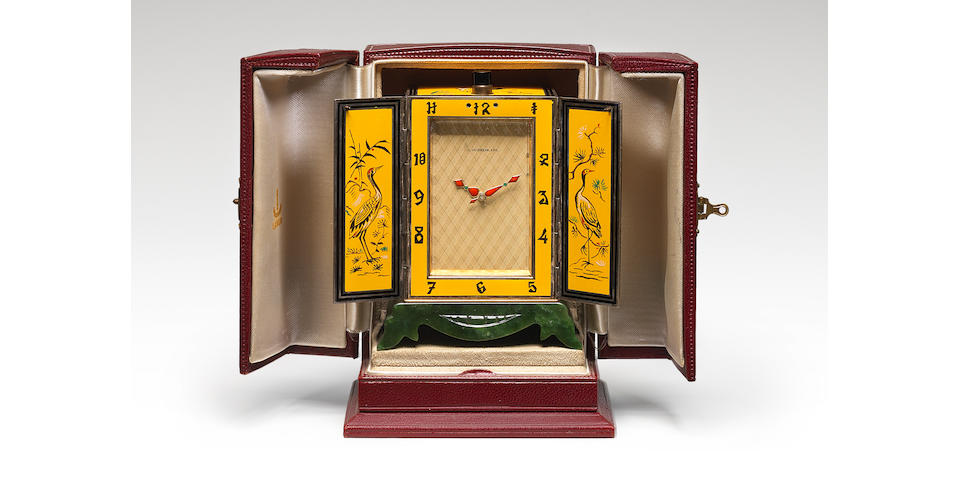 A fine and rare early 20th century enamel-decorated minute repeating silver travelling clock with sprung shutters in original presentation case  E.Gubelin