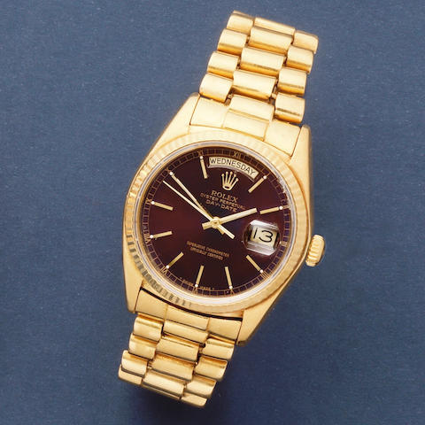 Rolex. An 18K gold automatic calendar bracelet watch with tropical dial  Day-Date, Ref: 18038, Circa 1978
