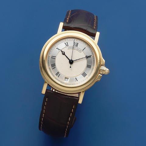 Breguet. An 18K gold automatic calendar wristwatch  Marine, Circa 1995
