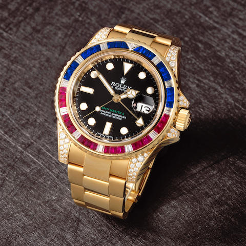 Rolex. A fine 18K gold, diamond, ruby and sapphire set automatic calendar bracelet watch with dual time zone  GMT Master II, Ref: 116758, Circa 2007