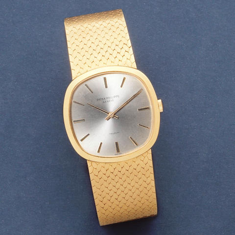 Patek Philippe. An 18K gold manual wind cushion form bracelet watch retailed by Trucchi  Ellipse, Ref: 3544/1, Circa 1980