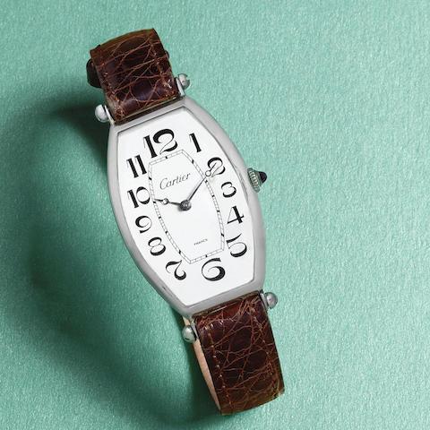 Cartier. A rare and early platinum and gold manual wind tonneau form wristwatch  Tonneau, Circa 1925