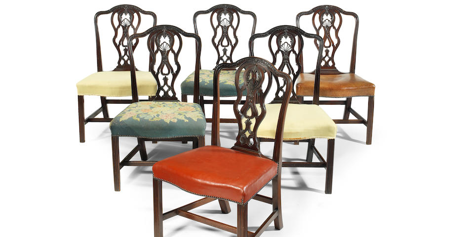 A near set of twenty-two mid Victorian carved mahogany dining chairs retailed by Bertram & Son, in the George III style (22)