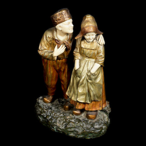 A patinated bronze and carved ivory figure group of two Dutch children by Joseph D'Aste SIGNED IN CAST, CIRCA 1920
