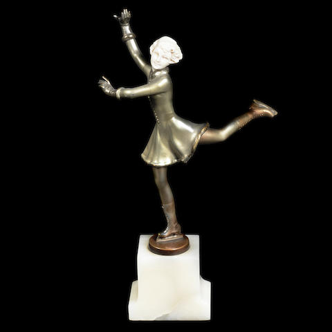 an art deco silvered bronze and carved ivory study of a female ice skater by josef Lorenzl SIGNED IN CAST, CIRCA 1925