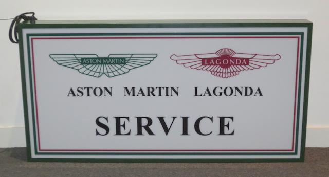An 'Aston Martin Lagonda Service' illuminating garage sign,