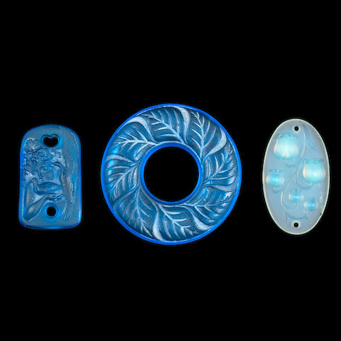 THREE RENÉ LALIQUE FROSTED AND POLISHED GLASS PENDANTS - 'COLOMBES', 'FEUILLES' AND MUGUET ALL SIGNED 'R.LALIQUE'; PRE 1945