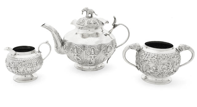 MILITARY INTEREST: An early 20th century Indian silver matched three-piece tea service unmarked