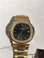 Patek Philippe. A fine 18K gold and diamond set automatic calendar bracelet watch  Nautilus, Ref: 3700/013, Circa 1979