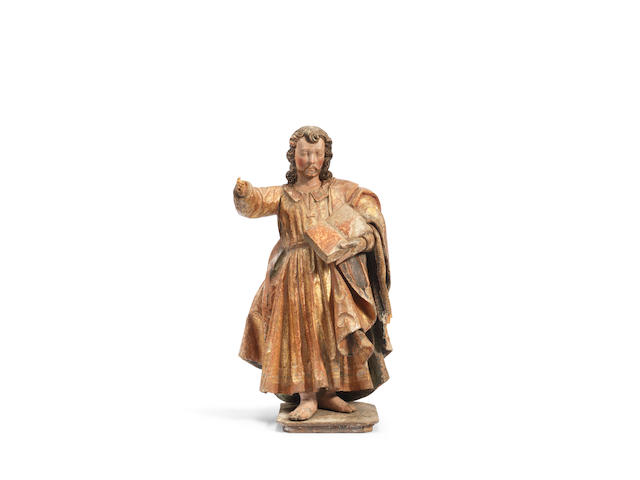 A 16th century carved and polychrome decorated figure of a saint, probably St Paul