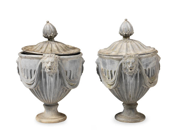 A pair of 18th century style lead garden urns and covers possibly cast by H Crowther (2)