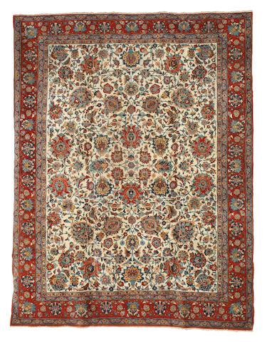 A Qum Carpet  Central Persia,  315cm x 235cm