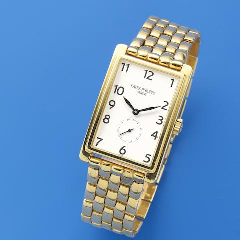 Patek Philippe. An 18K gold manual wind rectangular bracelet watch Ref: 5009, Sold 2004