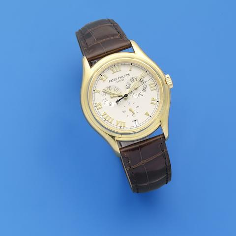 Patek Philippe. A fine 18K gold automatic annual calendar wristwatch with 24 hour indication Ref: 5035, Circa 2000