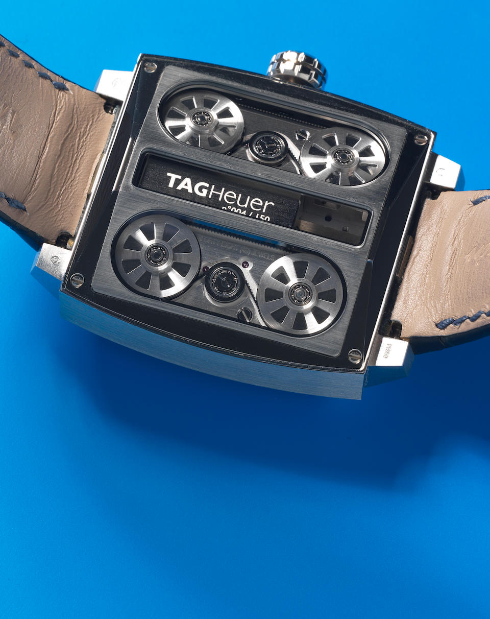 TAG Heuer. An exceptional and unusual platinum automatic belt driven semi-skeletonised wristwatch  Monaco V4, Edition No.004/150, Circa 2009