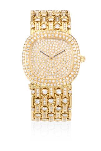 A custom made heavy 18K gold and diamond set automatic bracelet watch Circa 1980