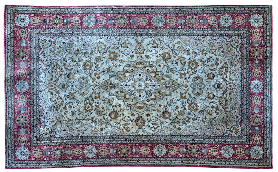 A kashan part silk rug