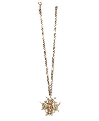 "PLATH (SYLVIA) Sylvia Plath's ""dragon"" pendant and chain, with maker's stamp ""Coro"", [1950s]"