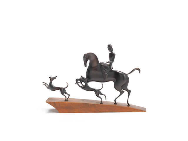 a stylish art deco patinated bronze hunting group by hagenauer STAMPED 'HAGENAUER WIEN', CIRCA 1925