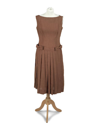 """PLATH (SYLVIA) A brown sleeveless dress with pleated skirt and waist belt, by """"Thocolette"""" of London and Vienna, [1950s]"""