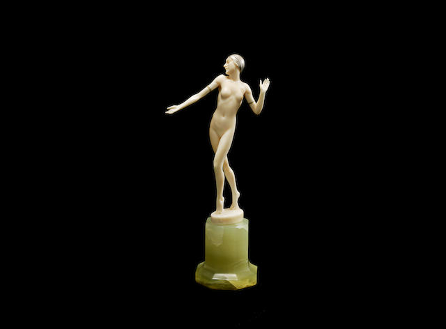 An Art Deco Carved Ivory Figure of a Dancing Female Nude by Ferdinand Preiss INSCRIBED TO BASE 'F.Preiss'; CIRCA 1925