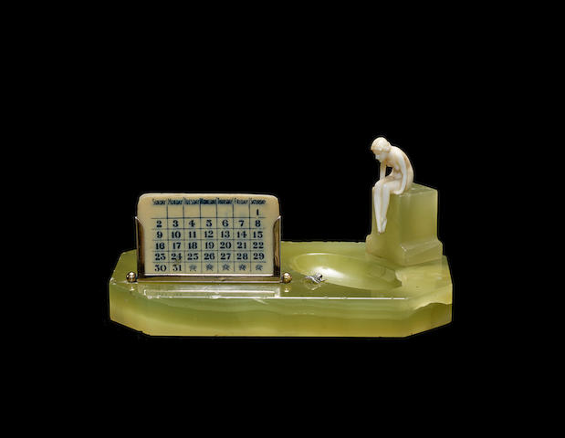'the princess and the frog' an art deco carved ivory, silver and onyx Desk calender; attributed to ferdinand preiss UNSIGNED; CIRCA 1925