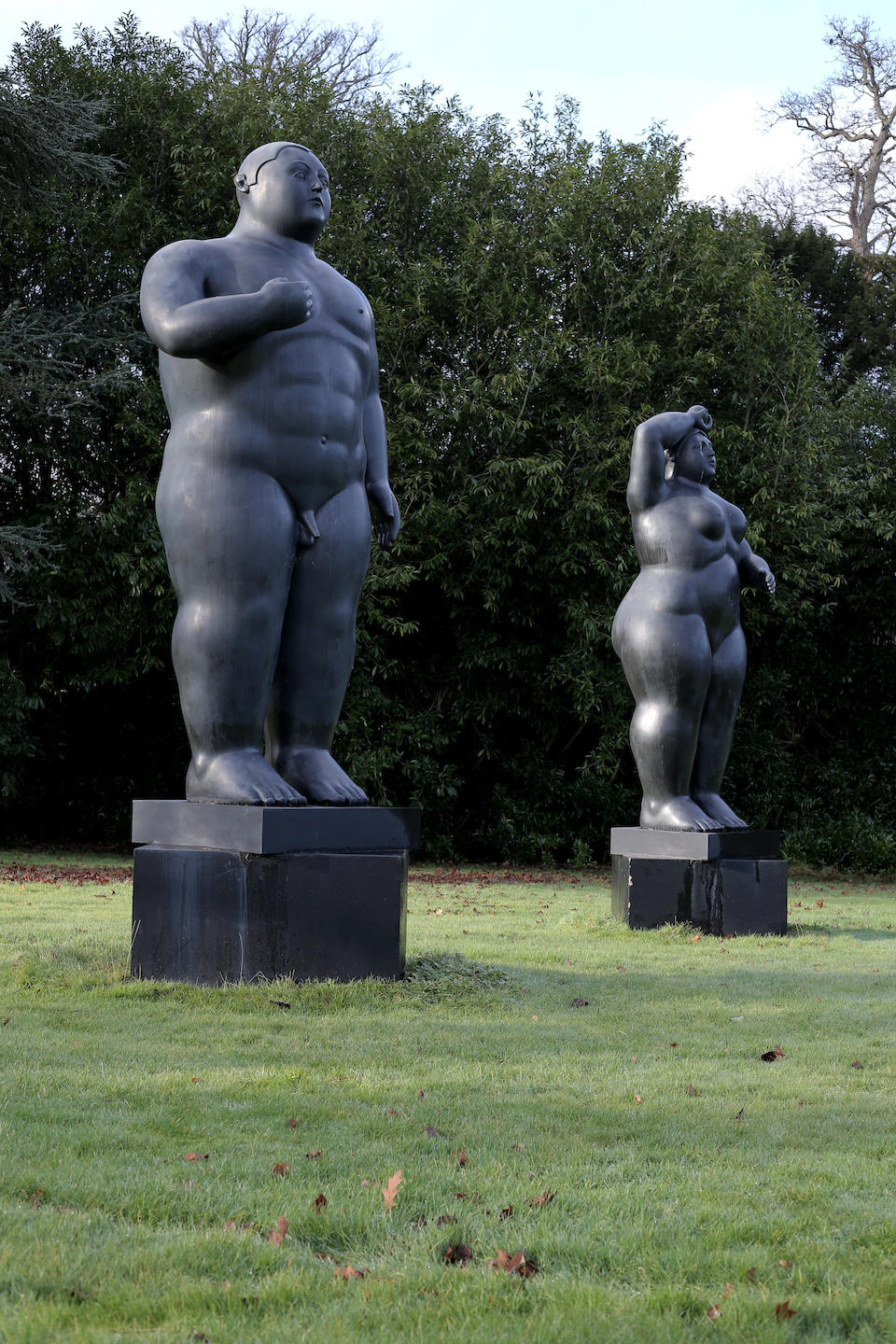 Fernando Botero (Colombian, born 1932) Adam and Eve, 2003each signed, numbered '3/3' and with the 'Fonderia Mariani Pietrasanta Italy' stamp (to the base)bronzeAdam 120cm  wide x 96cm deep x 337cm high (47 1/4in wide x 37 13/16in deep x 141 5/16in high) Eve 120cm wide x 90cm deep x 359cm high (47 1/4in wide x 35 7/16in deep x 141 5/16in high) This work was conceived in 2003, and is number 3 from an edition of 3.