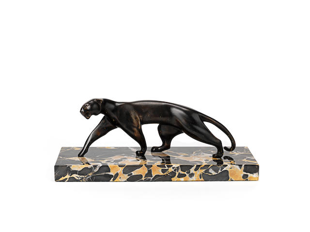 an art deco patinated Bronze model of a panther by michel Decoux SIGNED IN CAST, CIRCA 1925