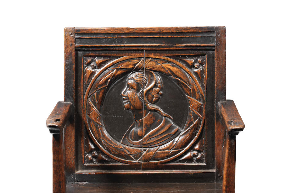 An exceptionally rare Henry VIII joined oak panel-back armchair, circa 1530