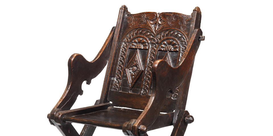 An exceedingly rare Elizabeth I oak armchair, a so-called Glastonbury chair, possibly Somerset and the surrounding area, circa 1570-1600