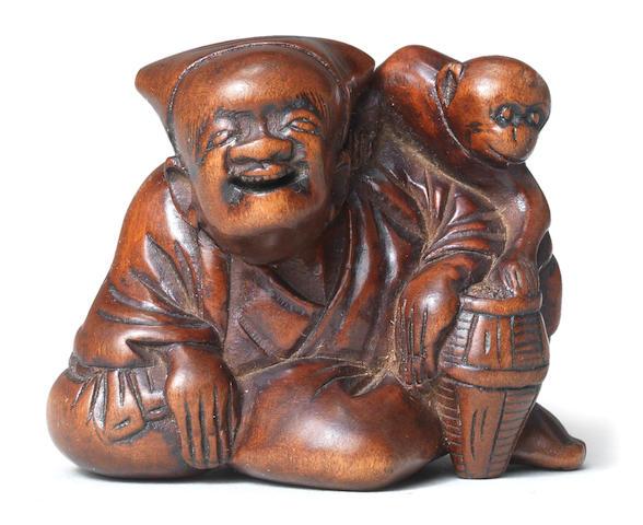 A wood netsuke of a sarumawashi (monkey-trainer) Late 18th century