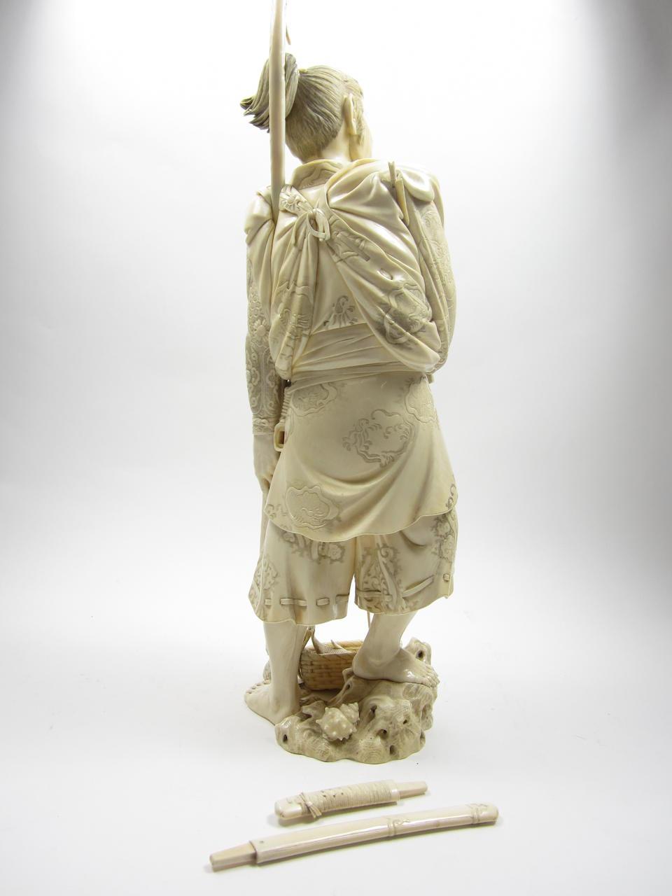 An impressive ivory okimono of Minamoto no Tametomo By Gyokuho, Meiji era