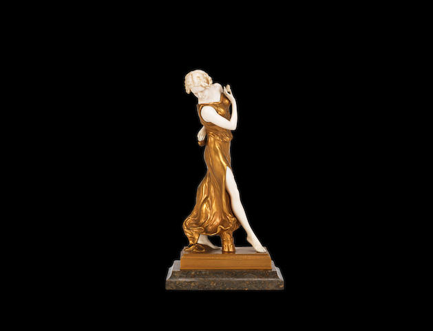 an art deco gilded bronze and carved ivory model of a dancer with castanets, by j.farays SIGNED IN CAST, CIRCA 1925