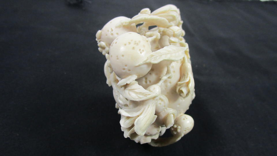 A rare ivory 'pomegranate' carving on stand 19th/early 20th century (2)