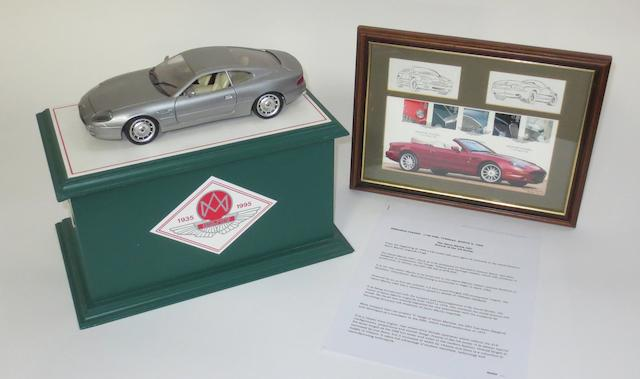 A 1:18 scale AMOC Jubilee limited edition model of an Aston Martin DB7,   ((3))