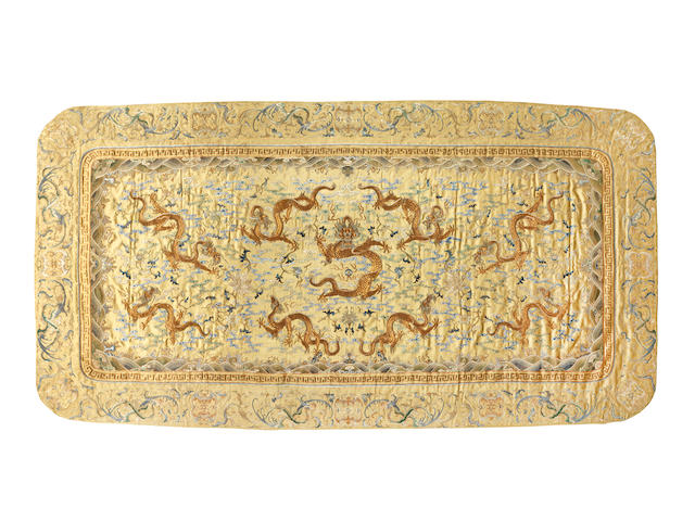 A rare imperial yellow-ground embroidered 'nine dragon' kang cushion cover Qianlong