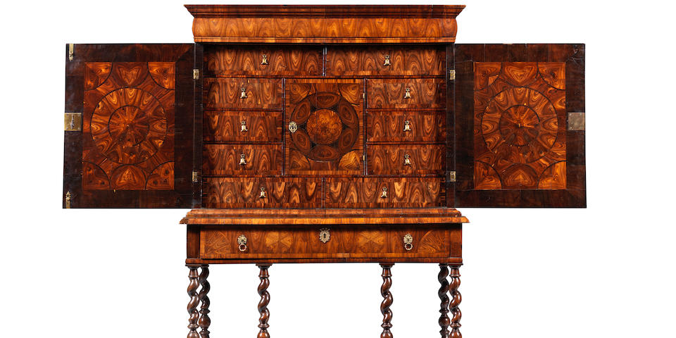A William and Mary kingwood, oyster veneered and ebony inlaid cabinet on a later stand Circa 1690, the cabinet in the manner of Thomas Pistor