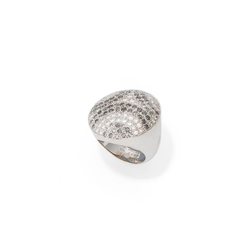 A diamond and black diamond ring, by Cartier