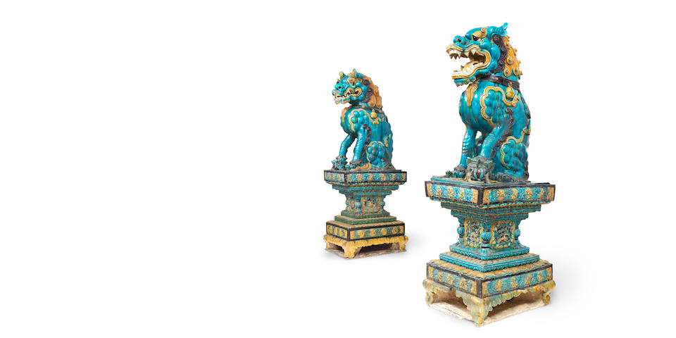A very rare pair of monumental fahua Buddhist lions on stands Late Ming Dynasty, 16th/17th century (4)