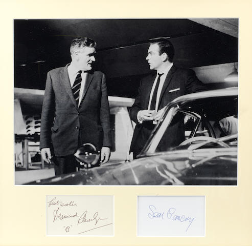 A James Bond 'Goldfinger' photograph with signatures of Sean Connery and Desmond Llewelyn,