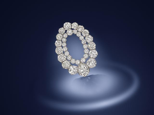 A diamond clip brooch, by Hennell,