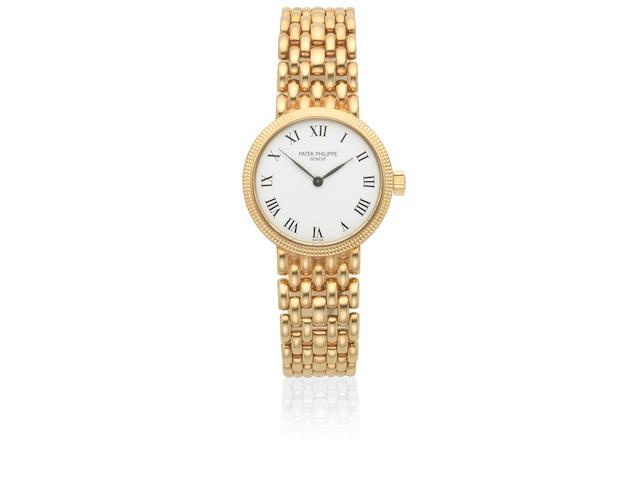 Patek Philippe. A lady's 18K gold manual wind bracelet watch  Calatrava, Ref: 4809/2J-011, Sold 7th December 2000